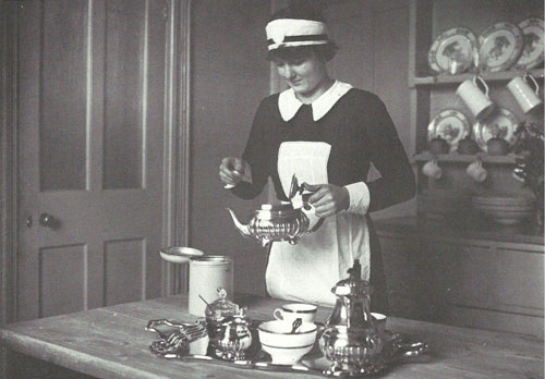 Maid pouring afternoon tea